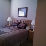 Pictured is a comfortable bedroom in a short term rental in Panama City  Beach.