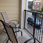 Relax on the balcony of your furnished apartment in Tallahassee.
