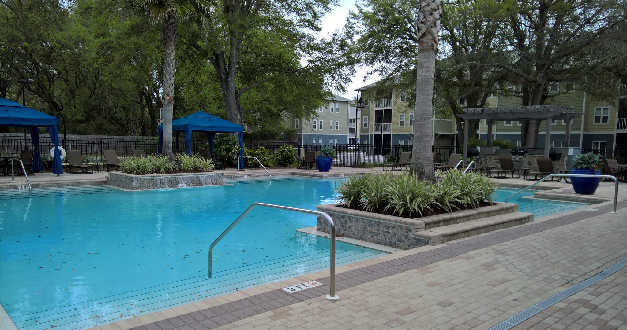 This is a photo of the pool area in one of our short term housing opportunities in Pensacola.