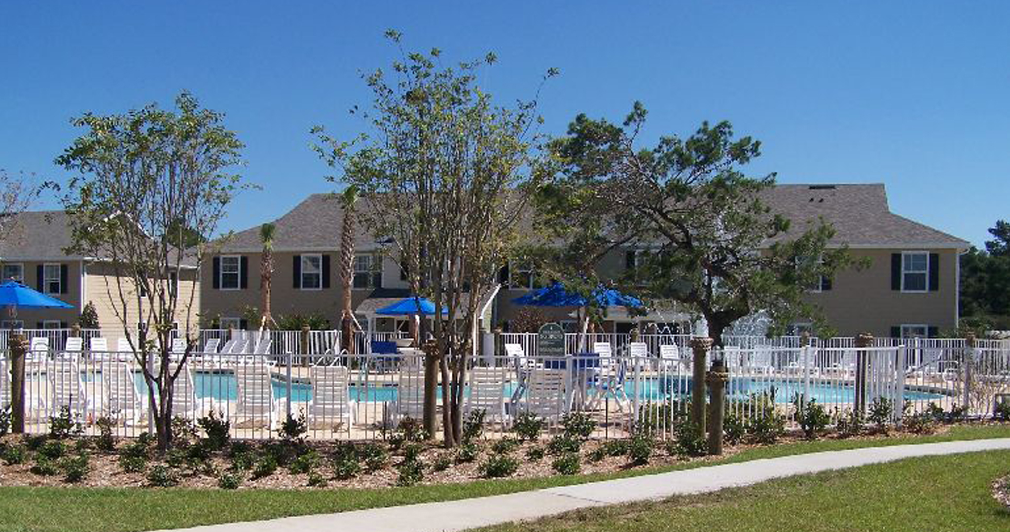 Bask in the sunshine at the pool area in your corporate housing rental in Panama City Beach.
